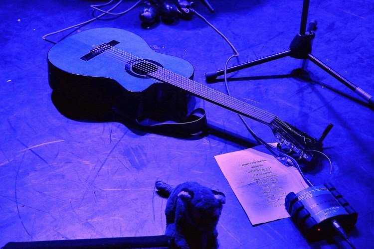 TPJ on stage with guitar in helene..blue